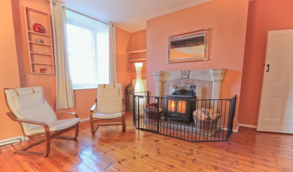 Wood burner and chairs at Friary Farmhouse